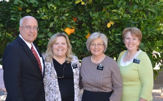 L to R: President and Sister Sweeney, Sisters Llewanne Bass and Carolee Wolfley.