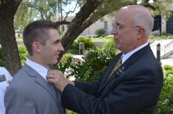 Elder Wallin gets a tie adjusted