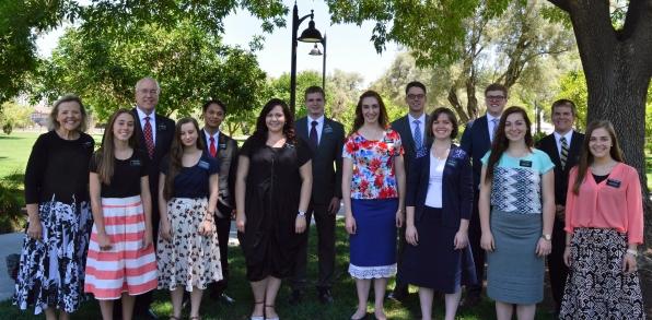 Sisters Sweeney, Mann, Allen, Valencia, Meyers, Mecham,, Reid and Chausow; Back row: Pres. Sweeney, Elders Agbuya, Johnson, Brown, Bockenstedt and Nicoll